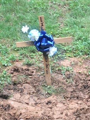 Graves for Duke II and four other dogs who died in a fire at Mountainside Pet Rescue, Upper Strasburg Road, stand in the sanctuary's pet cemetery Sunday, May 29, 2017.