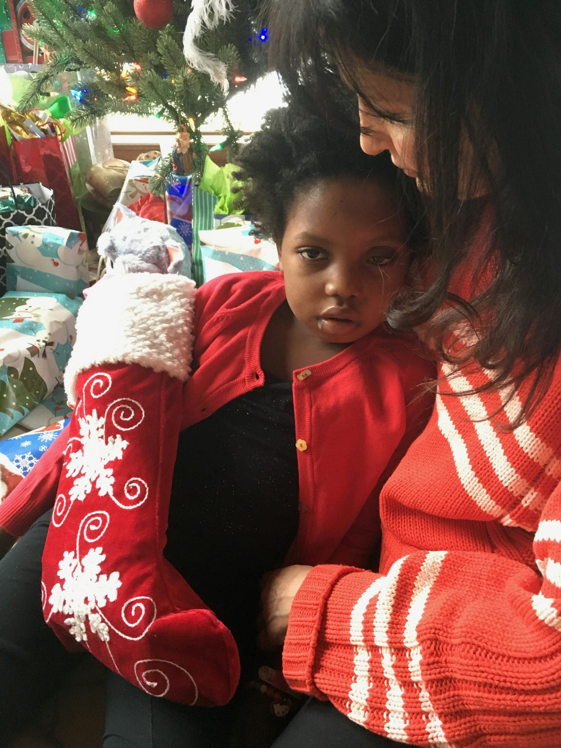 Chika and Janine on Christmas morning in 2016 at home in Michigan. Chika had wanted to celebrate in Haiti, but a severe setback with her tumor made travel impossible.