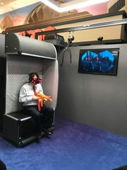 A player tries The Mummy VR experience at AMC Kips