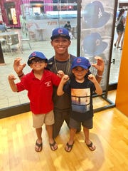 Palm Desert pitcher Jeremiah Estrada (middle) posing with his brothers Jerijah (left) and Jireh(right) after buying Chicago Cubs hats at the mall in Palm Desert. Estrada was drafted by the Cubs on the sixth round of this years MLB draft.