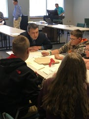 Clark Patterson Lee engineer Dave Chase speaks with a group of middle school students as part of a BOCES challenge.