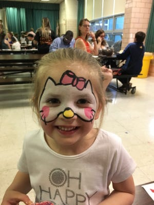 Pre-K student Jessica Zuk enjoys the Face Paint station at Linden School No. 9