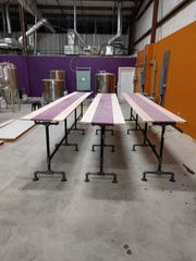 Tables at Tap & Screw Brewery's Madisonville location