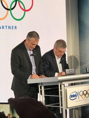 Intel CEO Brian Krzanich and IOC President Thomas Bach sign Olympics partnership agreement in New York.