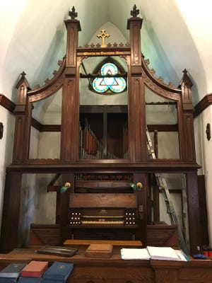 An 1871 Jardine organ stands inside United Presbyterian Church in Amenia on Saturday, June 24. The church has closed and the organ is being dismantled and donated to a church in Knoxville, Tennessee.