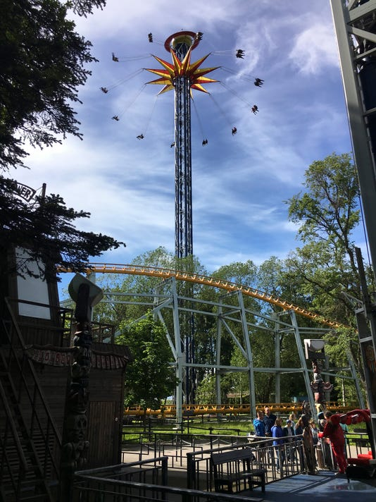 In this photo taken on Thursday, June 22, 2017, a view of the fairground attraction known as Divo Ostrov, (Wonder Island). Football fans can be taken on a roller-coaster ride at their World Cup games in St. Petersburg, and that's even before kickoff. An array of actual white-knuckle rides stand in the amusement park close to the stadium on their pre-match walk from the metro station.(AP Photo/Graham Dunbar)