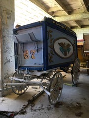 A retired circus wagon sits in a barn at the Circus Hall of Fame.