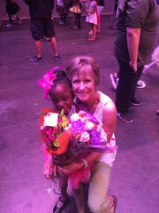 Keshia McLaughlin and her mother, Kim McLaughlin, attend the Dance Discovery dance recital at the Abilene Convention Center on Mother's Day.