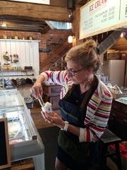 Deb Rhodes of The Refinery dips up a scoop of their new Bliss Artisan ice cream in fried corn flavor. It was as good as it sounds.