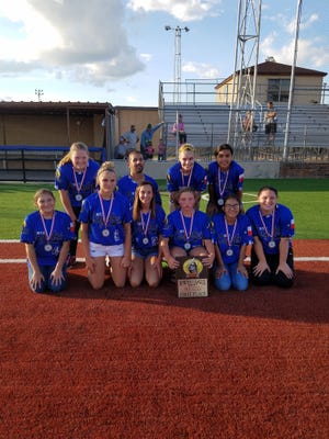 The North Texas Coyotes are the 14 years old and younger, first-place winners of the Sunrise Optimist Girls Softball League. They are, bottom row: Hope Cardona, Whitney Zaloski, Leah Gerred, Raylea Parsons, April Solorio and Hannah Holley. In the top row are  Kailee Crocker, Coach Randy Solorio, Kaitlin Anglin and Iliana Meza. Not pictured are Emma Schubert, Marisa Frazier, Ciara Bazile, Layni Chitwood, Coach Michael Frazier and Coach Clay Bazile.