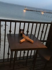 Grab a table with a beachfront view and enjoy dinner