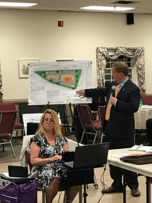 Engineer Thomas Pugsley outlines a proposed Wawa on Plaza Road in Oakland.