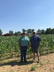 Noah and Matthew Bassett, owners of M & N Farm, stand