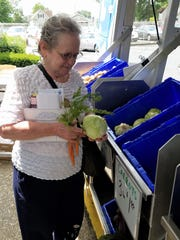 "Sharon Laster enjoyed shopping at the Seton Harvest vegetable van outside SWIRCA and More on a recent Thursday.  ""I think this is a very good idea,"" she said."