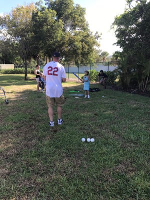 Palm Beach Cardinal Shane Billings enjoys interaction recently with families staying at Quantum House. Team members visited, provided dinner and enjoyed being able to hang out with them.