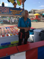 Vicki Lambeth works the fish game, where no one leaves without a prize.