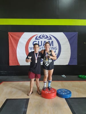 Julius Naranjo and Jacinta Sumagaysay take first place in the men's and women's categories in the Guam Weightlifting Federation Open at Crossfit Chamorri on July 29, 2017.