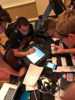 A group of hackers at last year's DefCon computer security conference in Las Vegas attempt to (legally) break in to a touch screen voting machine. The effort was part of a weekend-long Voting Machine Hacking Village at the conference aimed at raising awareness about vulnerabilities to the U.S. election system.