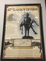 The 42nd Rainbow Division's Rainbow Soldier bronze in France is a part of the Croix Farm memorial. This is located at City Hall.