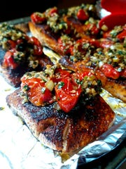 Jaggery can be used anywhere you'd find brown sugar, for example in the spice rub for this bronzed salmon with a tomato topping.