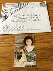 The envelope and photo sent when Ellen Brotschol Noble first reached out to her sister, Michelle Carlson.