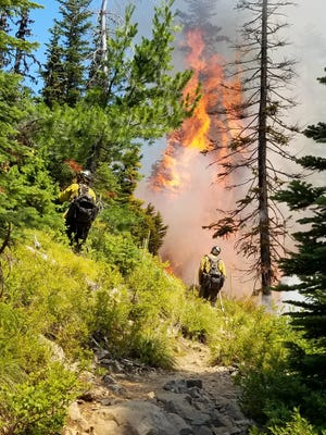 Firefighters work the Whitewater Fire, which has caused numerous closures in the Mount Jefferson Wilderness.