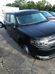 The wheels and rims were stolen off of a Ford Flex in the dealership parking lot at Candy Ford in Charlotte, Mich.