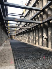 The floor of the repair shaft is seen 65 feet below 15 Mile Road in Fraser on August 11, 2017. A steel mesh has been placed at the bottom of the shaft and concrete will be poured over the steel mesh. When the new pipe is installed, it will rest on the concrete pad. The shaft is 300 feet long and 28 feet wide.