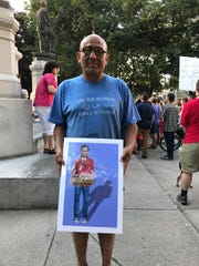 Antonio Cruz Cavaleta, 58 and from downtown Rochester, came to the Charlottesville Solidarity Rally with his Mr. Rogers-themed sign because he worries white nationalists are becoming louder and louder.