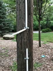 "A shattered eruv marker, or ""lechi,"" on East Crescent"