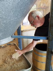 Dr. Duane Kuhlenschmidt and his son Jesse use grains grown on thier own Posey County farms in brewing Dusty Barn liquors.