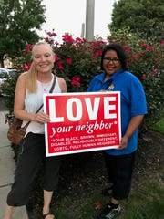 """Dee Kalman, of Westwood, brought this sign to the """"United"""