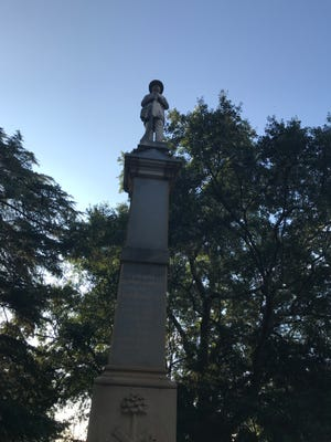 The Greenville County Confederate Monument stands along Main Street near the entrance to Springwood Cemetery.