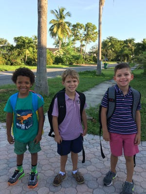 Marcus Schaab (kindergarten), Jackson Burmeister (first grade) & Hudson Burmeister (first grade) wait for the bus to Sea Gate Elementary.