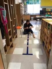 Kirstie Taylor Rostro, first-grade teacher at Lamar Elementary, readies her classroom.