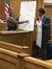 Florida Highway Patrol investigator David Brunner explains a diagram of the crash scene to Assistant State Attorney David Stamey on Wednesday, Aug. 23, 2017.