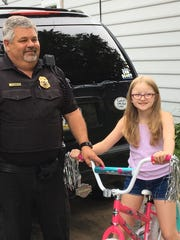 West Manheim Twp. Police Chief Tim Hippensteel presented 9-year-old Katelyn Thompson with a new bicycle on Friday, Aug. 18, 2017, after a thief stole hers. (Photos courtesy of Stephanie Thompson)