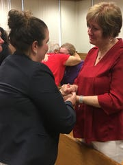 Sharon Mahar thanks Assistant State Attorney Hannah Potter after the Phillips trial in Wauchula.