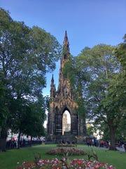 Tourists gather around the Sir Walter Scott Monument in Edinburgh, Scotland, July 8, 2017.