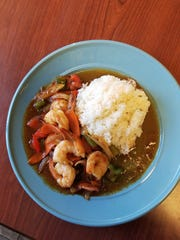 Meyer encouraged newcomers to Thai food to try the pad num phrig pao, a sweet shrimp stir fry with vegetables and a mild hint of chile flavor, but very little heat.