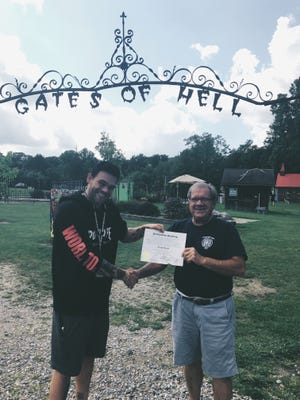 Elijah Daniel, left, newly proclaimed 'mayor' of Hell, Mich. with local business owner John Colone on Aug. 30, 2017.