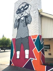 "The drawing of the ""big kid"" was created by Adam Bianchin of Redding as part of a motel mural in downtown Redding."