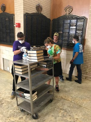 Teenagers with New Jersey Region of NCSY helping in the cleanup after Hurricane Harvey devastated Houston.