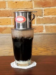 Try a Vietnamese coffee pour over at River Kitty Cafe. Sweetened condensed milk is topped with ice cubes and then fresh chicory-laced coffee. Stir to enjoy.