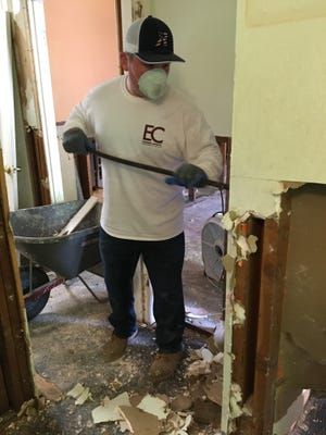 Camden County Freeholder William Moen Jr. removes wet Sheetrock from a Hurricane Harvey-flooded home in South Houston. Moen felt compelled to volunteer while visiting Texas on a long-planned trip to see a friend.
