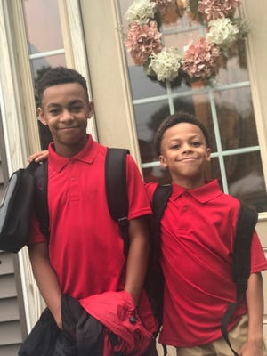 Confident to take on a new year, Terrance, sixth grade, and Jordan, third grade, in Vineland.