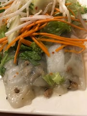An appetizer at Mekong Cafe, 5930 W. North Ave., is banh cuon, steamed rice noodle rolls filled with  ground chicken, wood ear mushrooms and fried shallots. They're garnished with lettuce, carrot, cucumbers and bean sprouts.