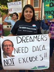 Dulce Elias Martinez, of Harrisonburg, protests President Trump's DACA decision this week outside the Augusta County Courthouse in Staunton, Va., on Friday, Sept. 8, 2017.