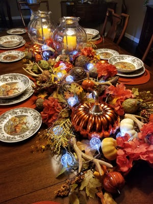 Six-step process to creating the perfect fall centerpiece. Some battery operated lights can make the festivities truly light up.