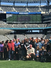 The crowd poses for a group picture at MetLife Stadium